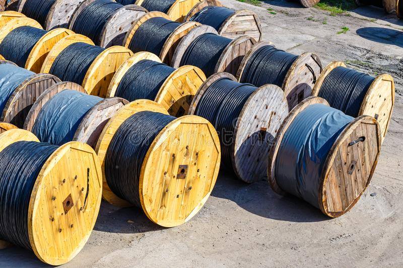 Electricity cable on wooden spools. On the floor stock image