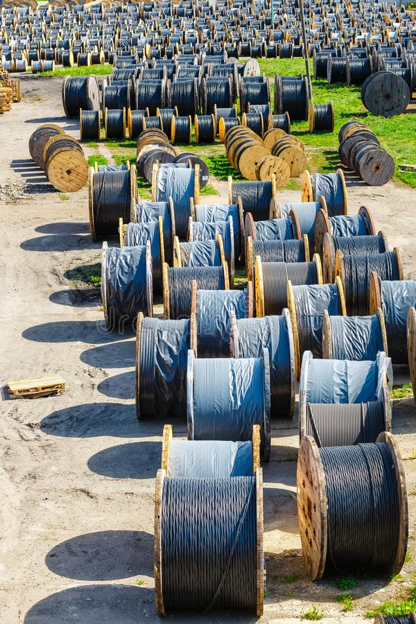 Electricity cable on wooden spools. On the floor stock photography