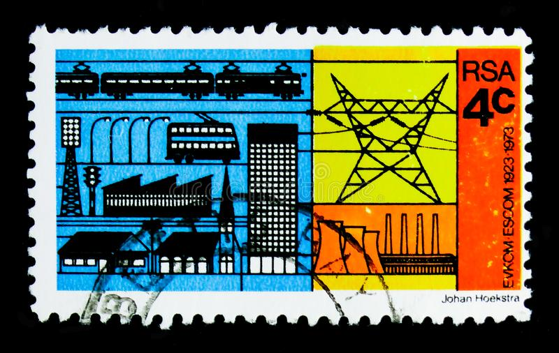 Electricity consumers and producer, 50th anniversary of ESCOM serie, circa 1973. MOSCOW, RUSSIA - OCTOBER 1, 2017: A stamp printed in South Africa shows royalty free stock image