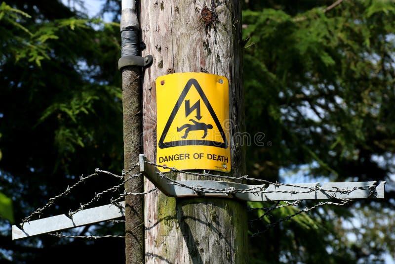 Electricity Danger Sign on a Timber Pylon. Danger of Death sign on a timber electricity pylon stock photos