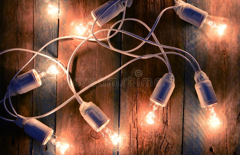 Electricity. Garland with incandescent lamps royalty free stock photo