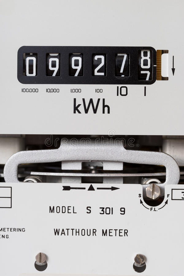 Electricity meter. Close-up and showing reading digits, kilowatt hour symbol and rotating measuring dial stock photo