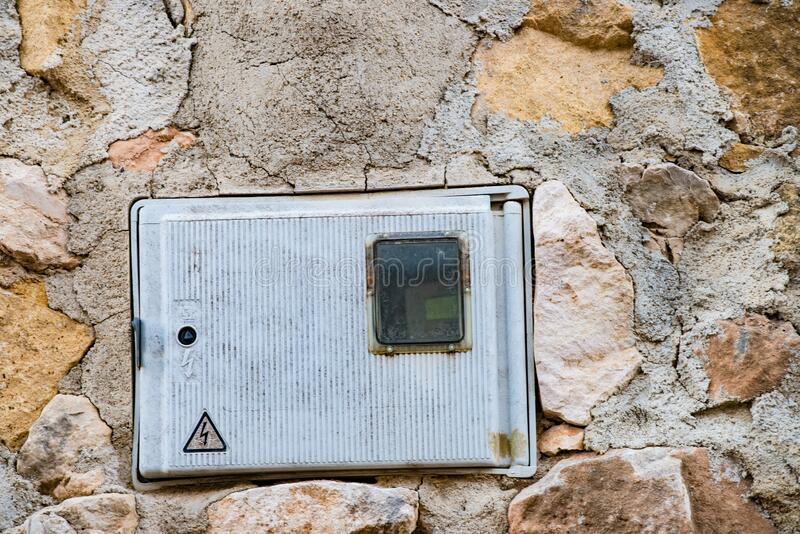 Electricity meter on a wall royalty free stock photos