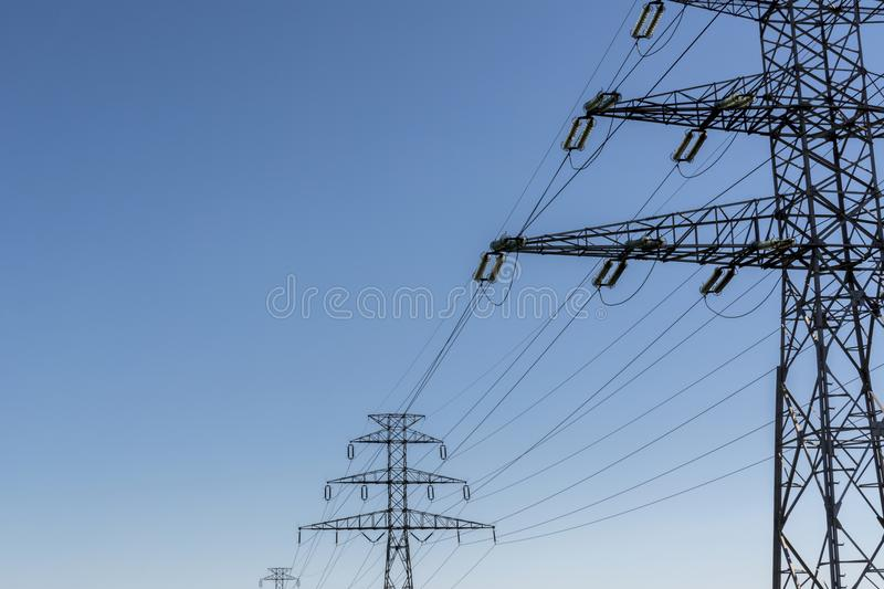 Electricity pillar. High-voltage line royalty free stock photo