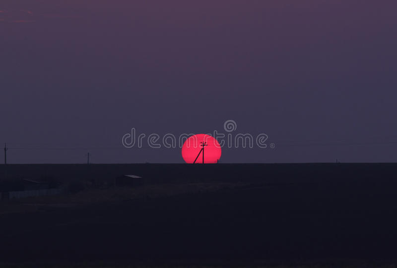 Electricity pole over rising sun. View on electricity pole over rising sun stock photo