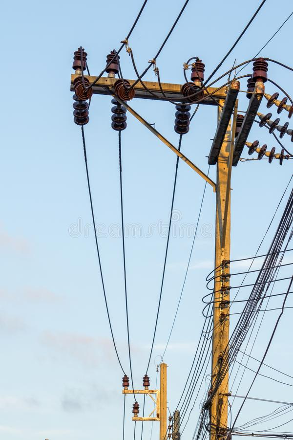 Electricity poles and wires connect to the high voltage power transformer.. royalty free stock image