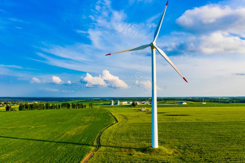 Electricity production in countryside. Wind turbine on farm. Ecologically friendly energy source. Electricity production in the countryside. Wind turbine on farm royalty free stock photos