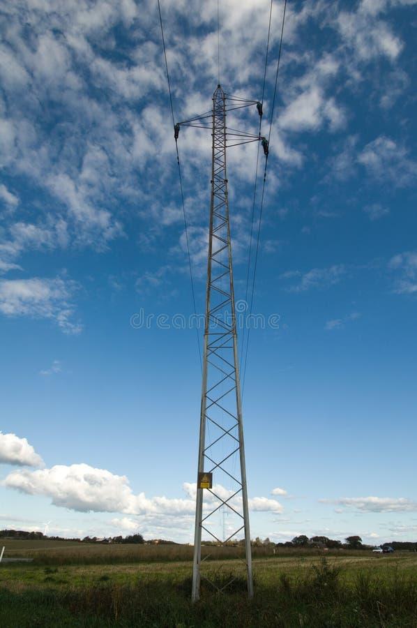 Electricity pylon against blue sky stock photo