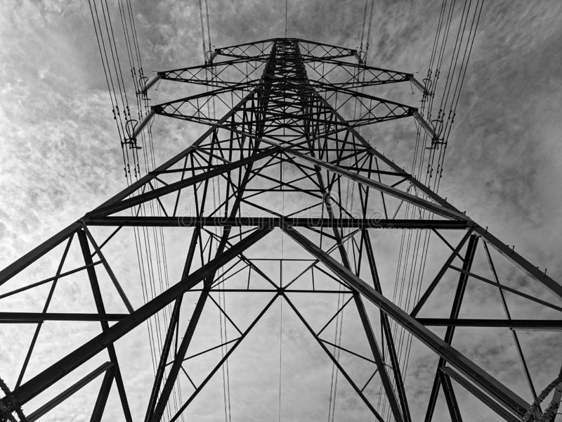 Electricity pylon in black and white stock photo