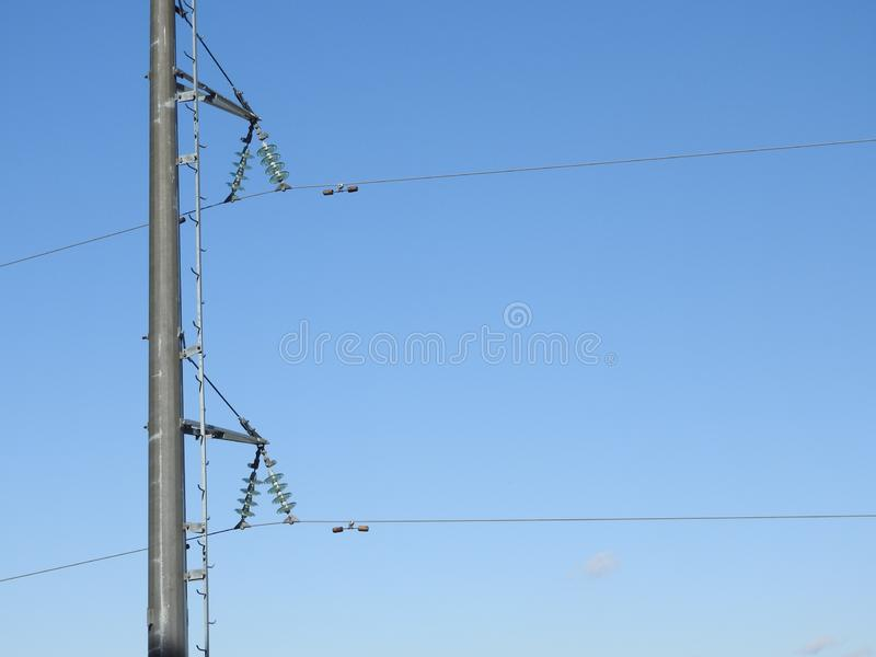 Electricity pylon, electric transmission tower, against the blue sky. Energy tower royalty free stock photography