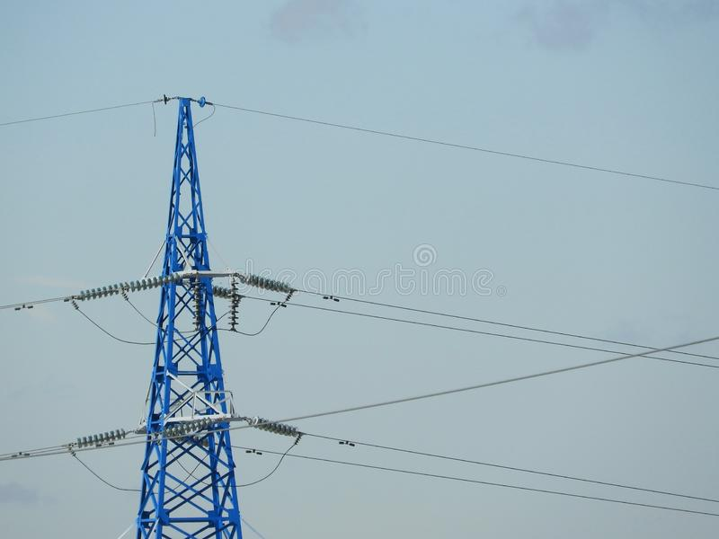 Electricity pylon, electric transmission tower, against the blue sky. Energy tower stock image