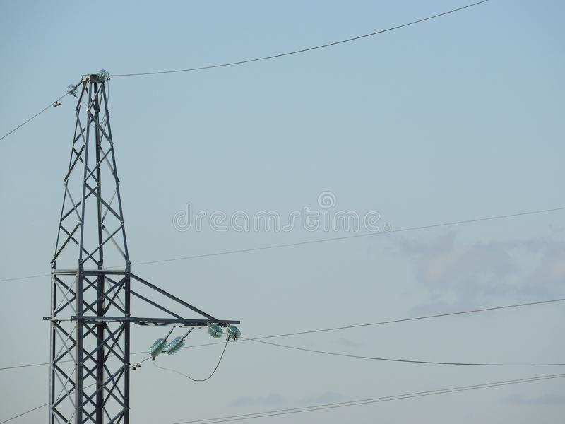 Electricity pylon, electric transmission tower, against the blue sky. Energy tower stock photo