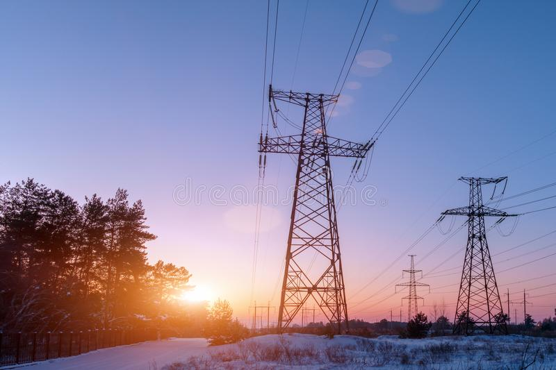 Electricity pylon in a field with blue sky. stock photography