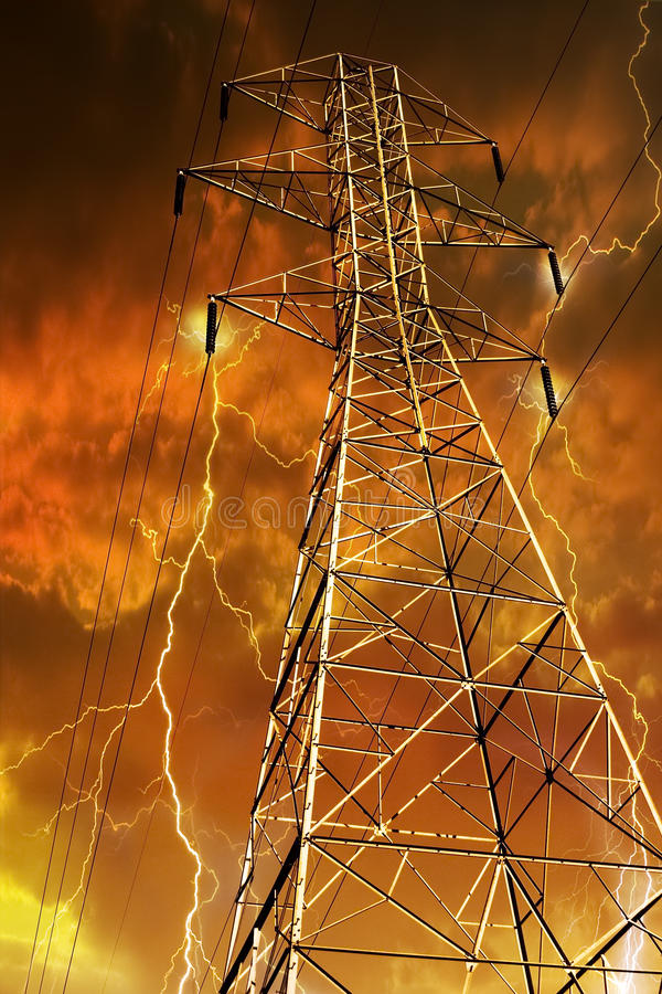 Electricity Pylon With Lightning In Background. Royalty Free Stock Photo
