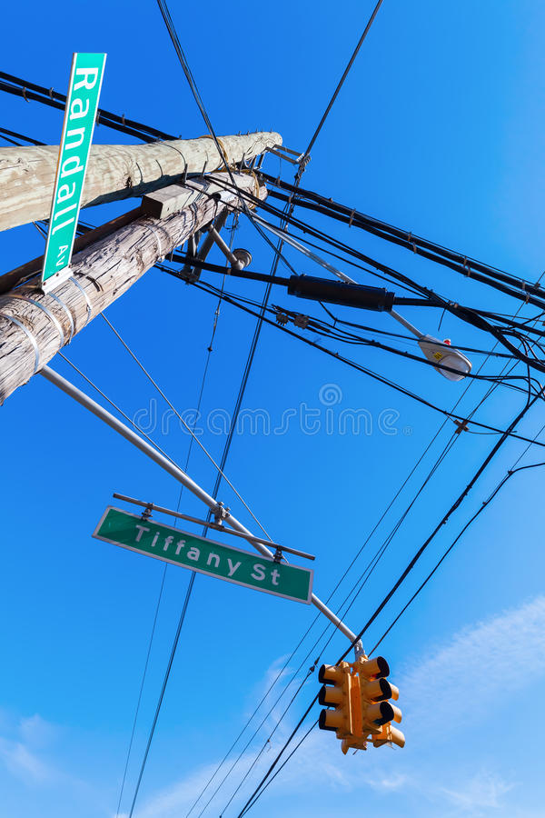 Electricity pylon in New York City. Electricity pylon with street signs in the Bronx, New York City royalty free stock image