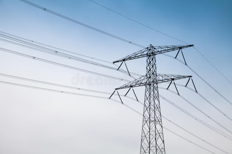 Electricity pylon. Steel lattice tower. Transmission power tower, electricity pylon. Steel lattice tower, used to support an overhead power line royalty free stock photos