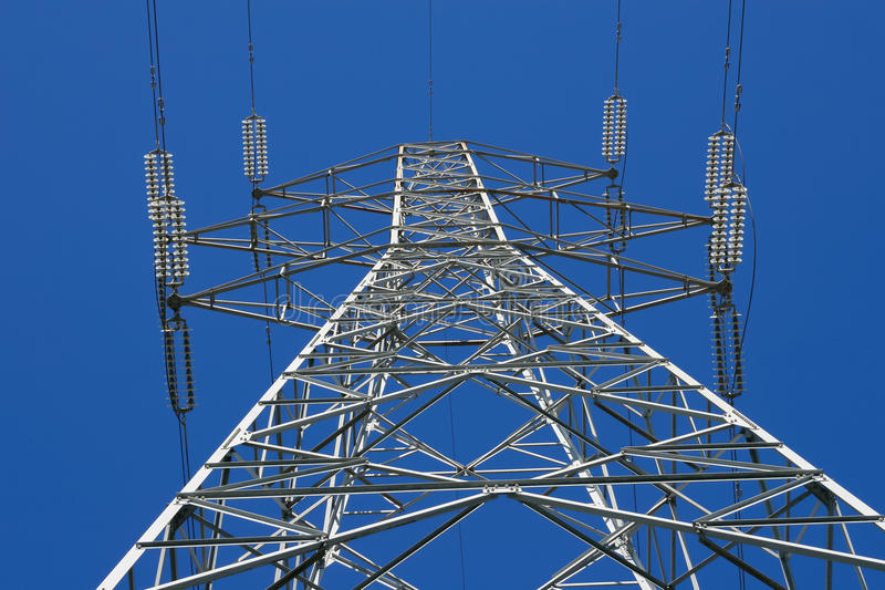 Electricity pylon - Stock image. High tension electrical power lines and pylon tower against sky. Modern industrial energy line royalty free stock photos