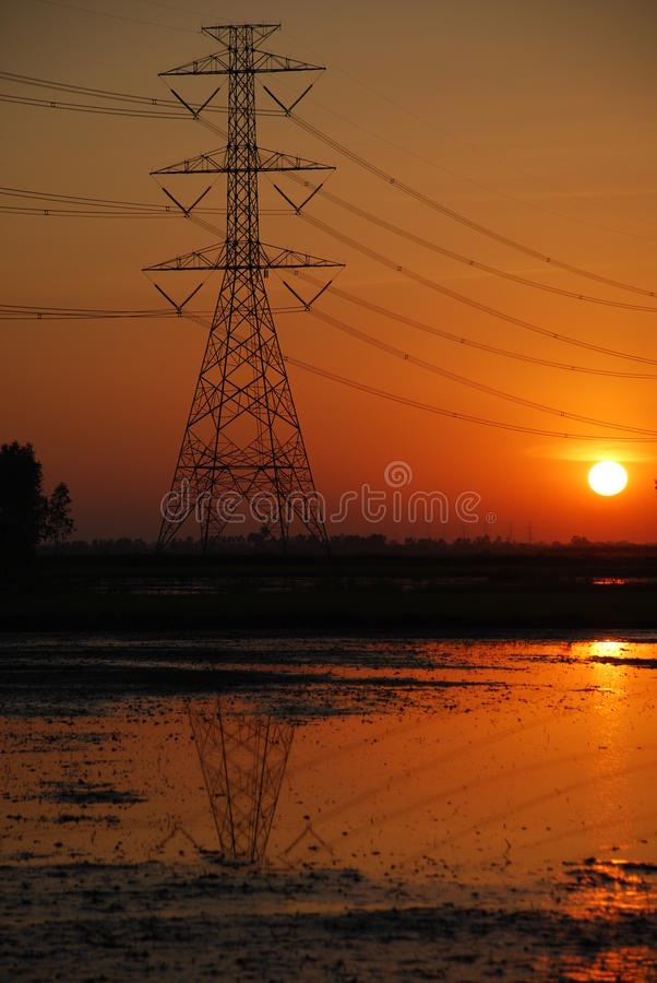Electricity pylon and Sunset royalty free stock image