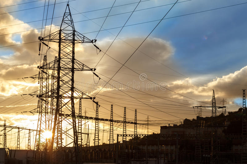 Electricity pylon at sunset stock photography