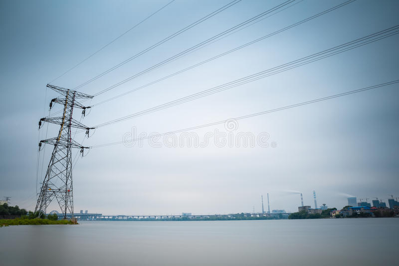 Electricity pylon and thermal power plant. Power transmission tower with a thermal power plant royalty free stock image