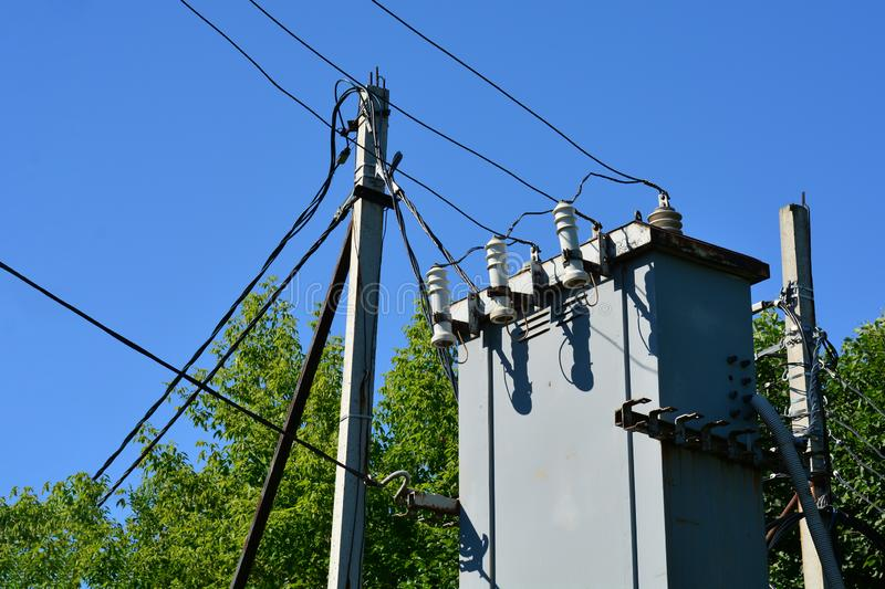 Electricity pylon with transformer and wires against a blue sky. The concept of electricity royalty free stock photos