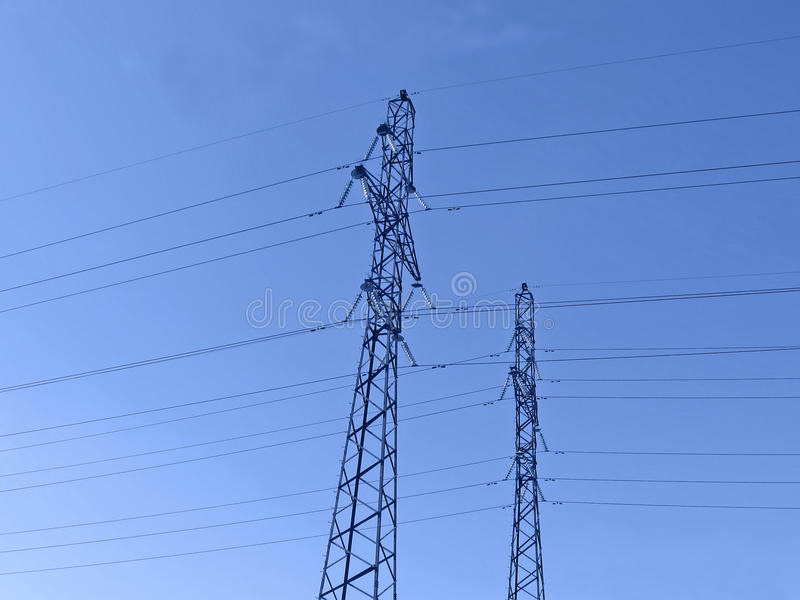 Electricity pylons (electrical powerlines), sunset stock photo