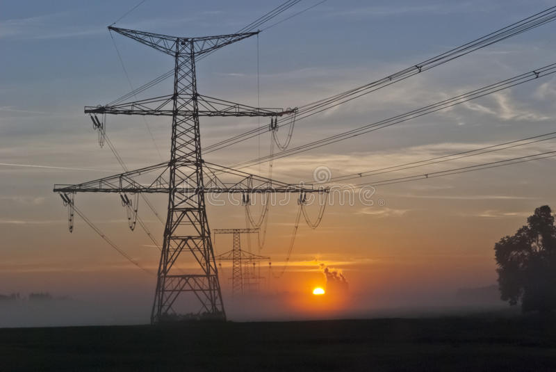 Electricity Pylons and nuclear power plant Temelin. Electricity Pylons at dramatic sunrise and power plant Temelin - Czech Republic royalty free stock photography