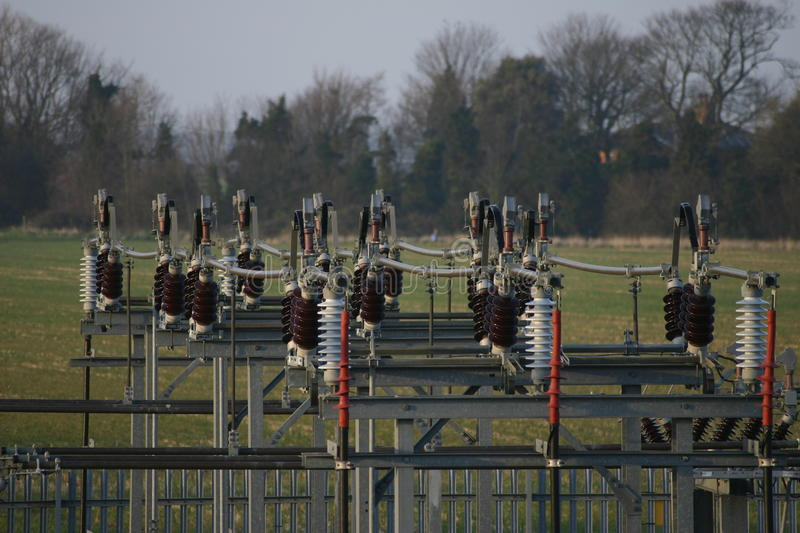 Electricity sub station. On the edge of fields with a background of trees stock image