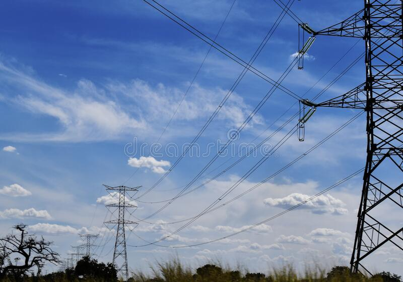 Electricity towers and its dangling cables stock photo