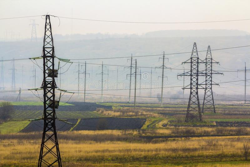Electricity Transmission Power Lines In Foggy Weather. High Volt ...