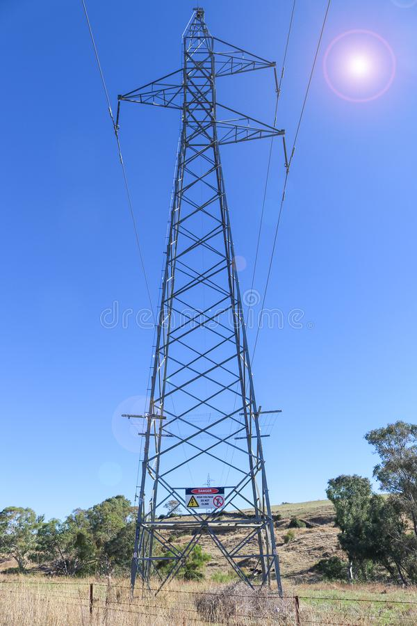 An electricity transmission tower with a red, black and white Da royalty free stock images