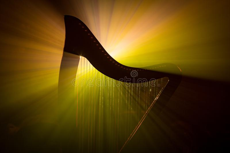 Electro harp in the rays of light royalty free stock photos