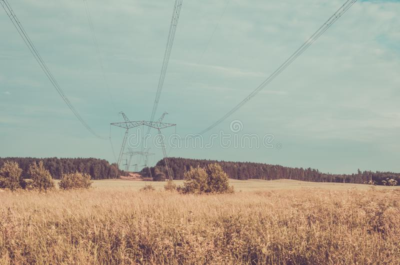 Electro high voltage towers/electro high voltage towers against the background of the sky. Toned royalty free stock images