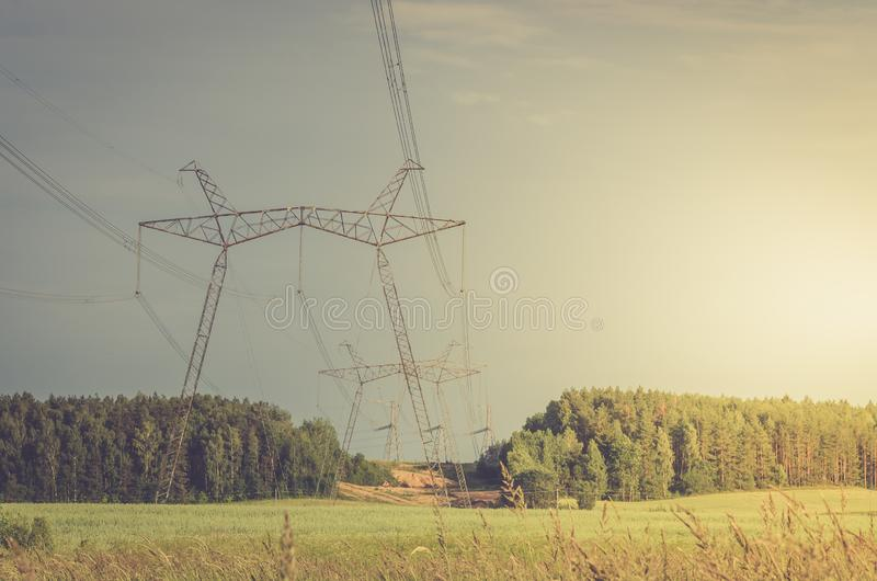 Electro high voltage towers/electro high voltage towers against the on a background sunset royalty free stock photography