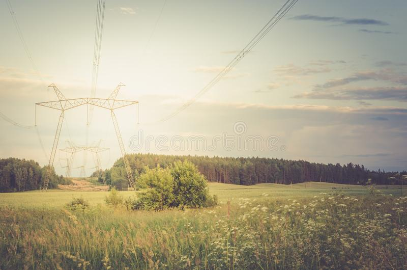 Electro high voltage towers/electro high voltage towers against the on a background sunset. Toned stock image
