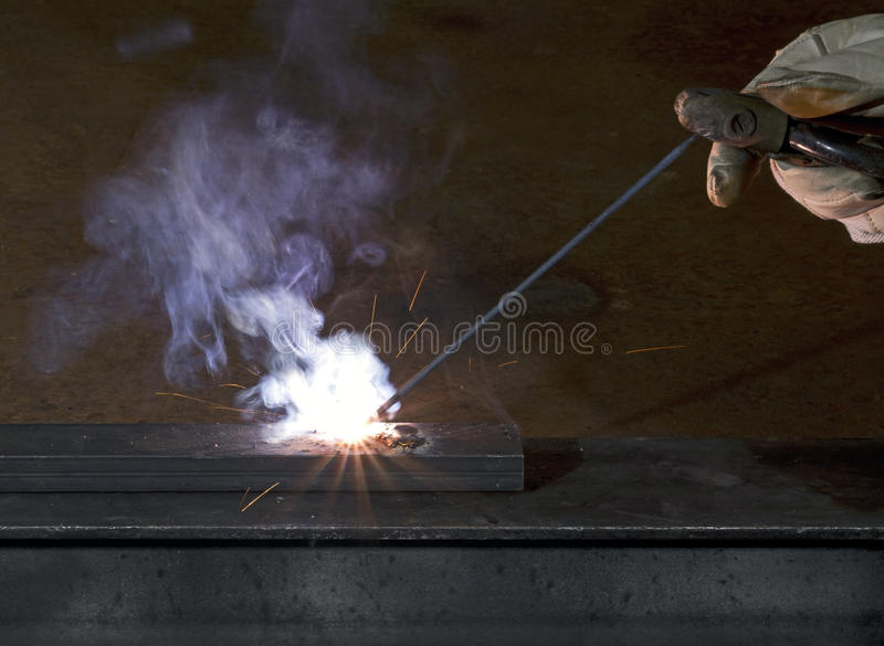 Electro-weld a peace of steal stock photos