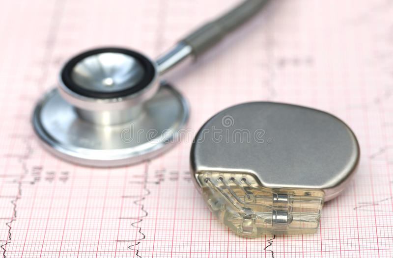 Electrocardiograph with stethoscope and pacemaker. Close up of electrocardiograph with stethoscope and pacemaker stock photography
