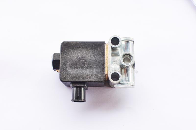 Electromagnetic control valve. Lifting and lowering the body platform, opening the sides of the truck on a white background stock image