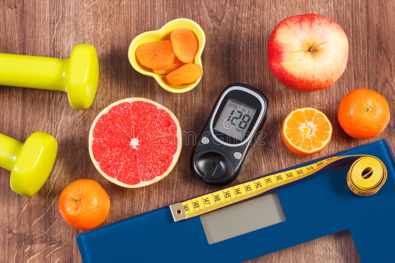 Electronic bathroom scale, glucometer, centimeter, healthy food and dumbbells for fitness, healthy lifestyles, diabetes and. Electronic bathroom scale for weight royalty free stock photography