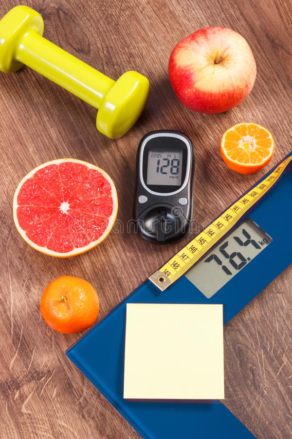 Electronic bathroom scale and glucometer with result of measurement, centimeter, healthy food and dumbbells, healthy lifestyles, d. Electronic bathroom scale and stock photos