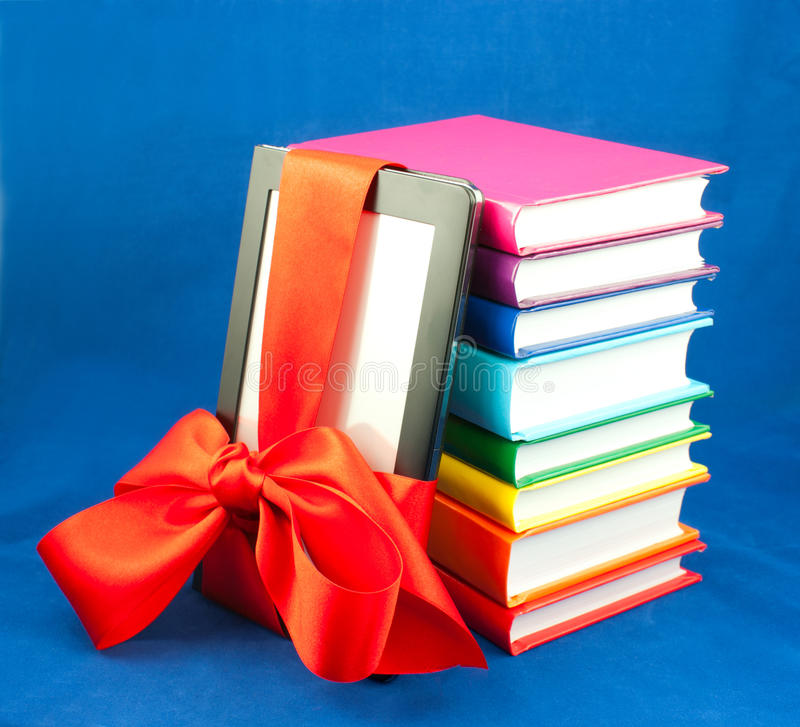 Electronic book reader tied up with ribbon and royalty free stock photos