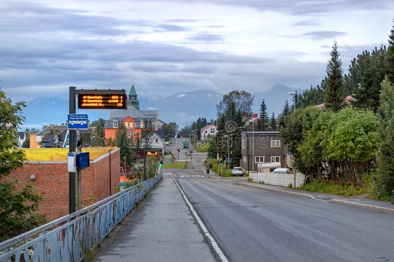 An electronic bus stop with timetable in Tromso, Norway.  stock photo
