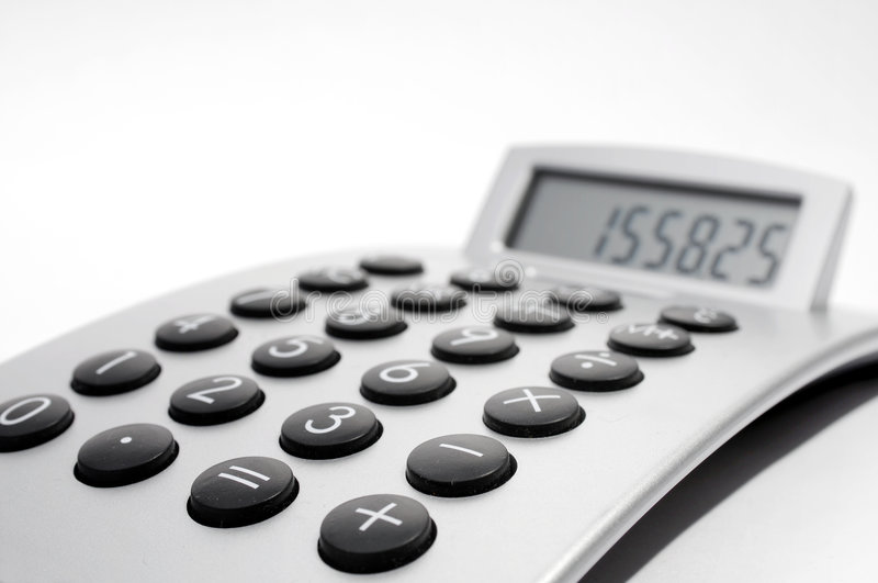 Electronic calculator. An electronic calculator on white background royalty free stock image