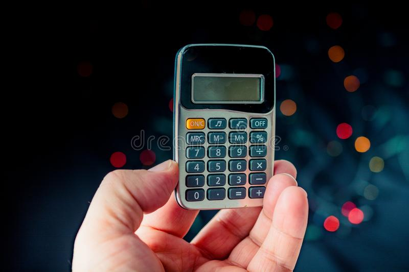 Electronic  calculator device with keyboard and display. In hand stock photo