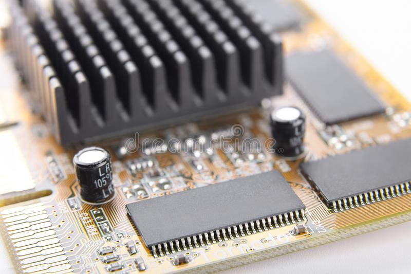 Electronic chip on a circuit board close-up, part of computer equipment, old electronic component stock images