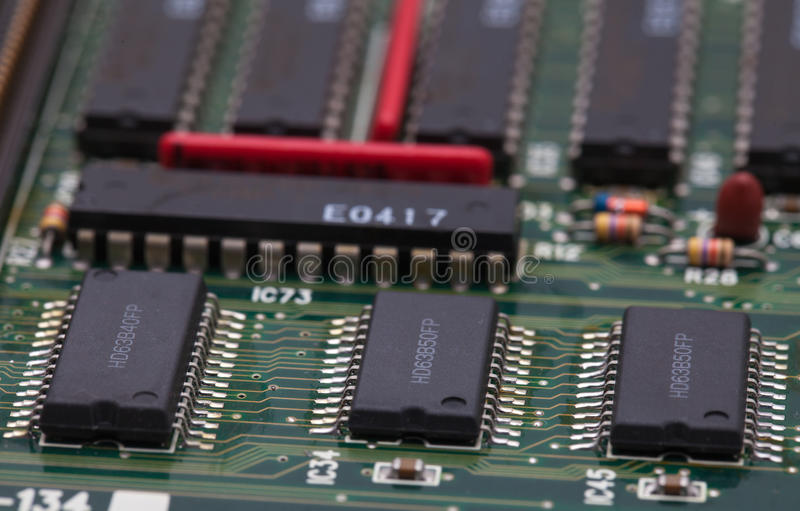 Electronic chip on green PCB.  royalty free stock images