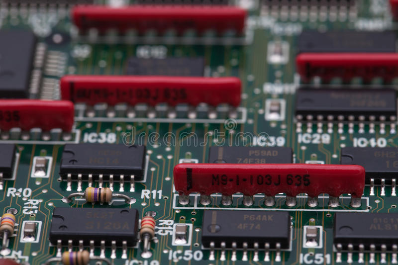 Electronic chip on green PCB and parallel resister.  stock image