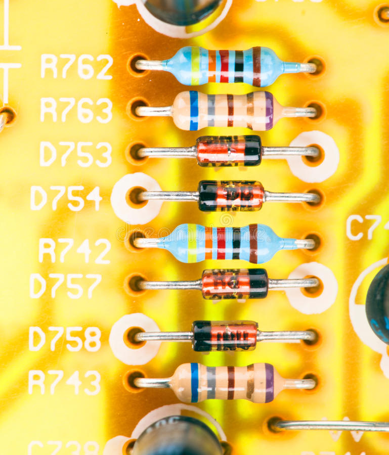Electronic chip and other components. Mounted on printed circuit stock photo