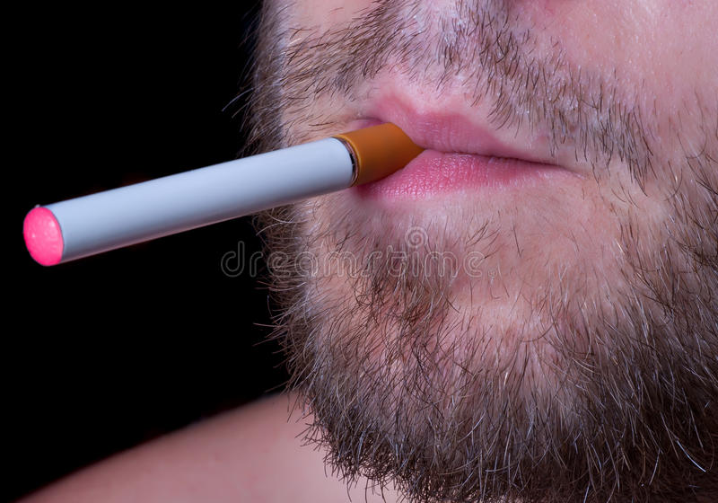 Electronic cigaret in lips stock images