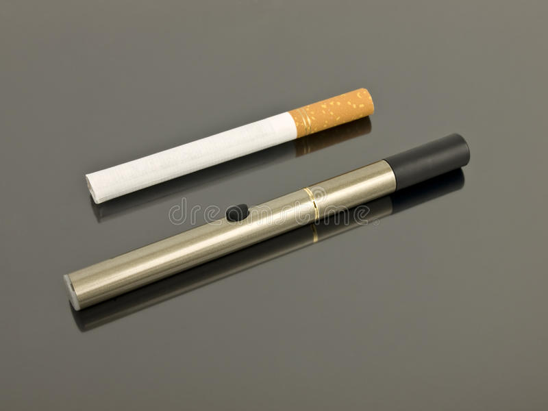 Electronic Cigarette with analog cigarette stock photo